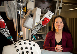 Photo of Caroline Cao in a lab