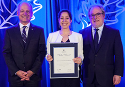 Photo of an alumna receiving Arbor Award
