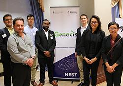 Hatchery team Genecis posing in front of banner